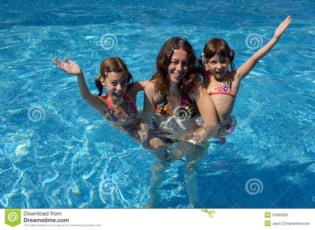 Happy family having fun in swimming pool on summer vacation, mother ...
