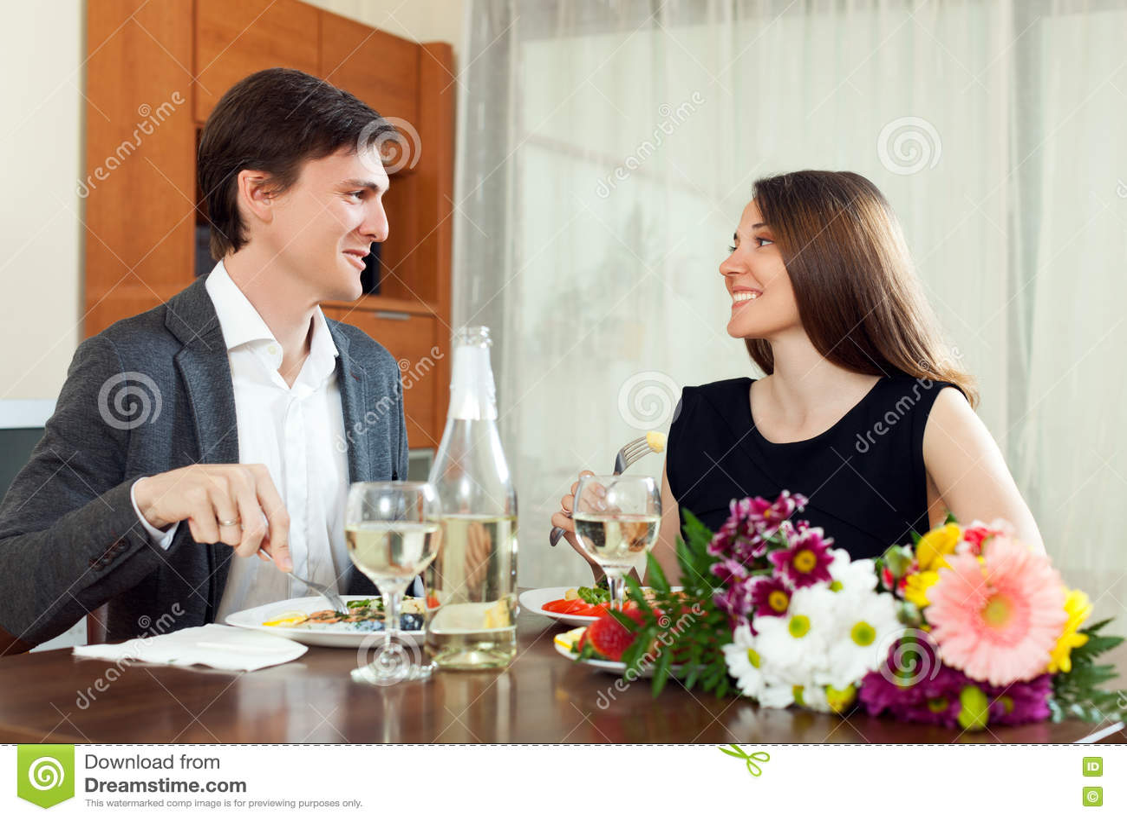 Happy family having romantic dinner and celebration