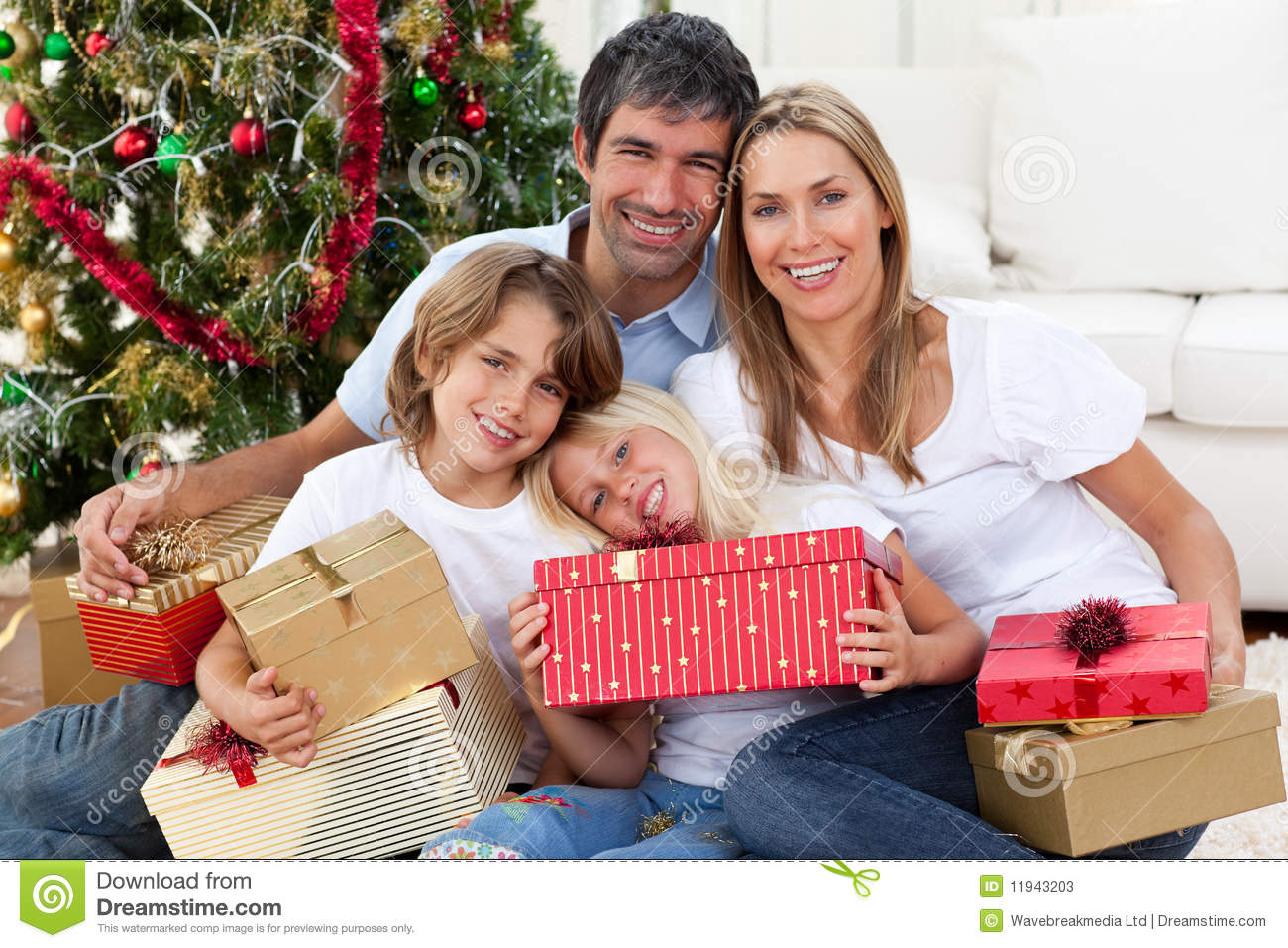 Happy Family Holding Christmas Gifts Stock Image - Image of female ...