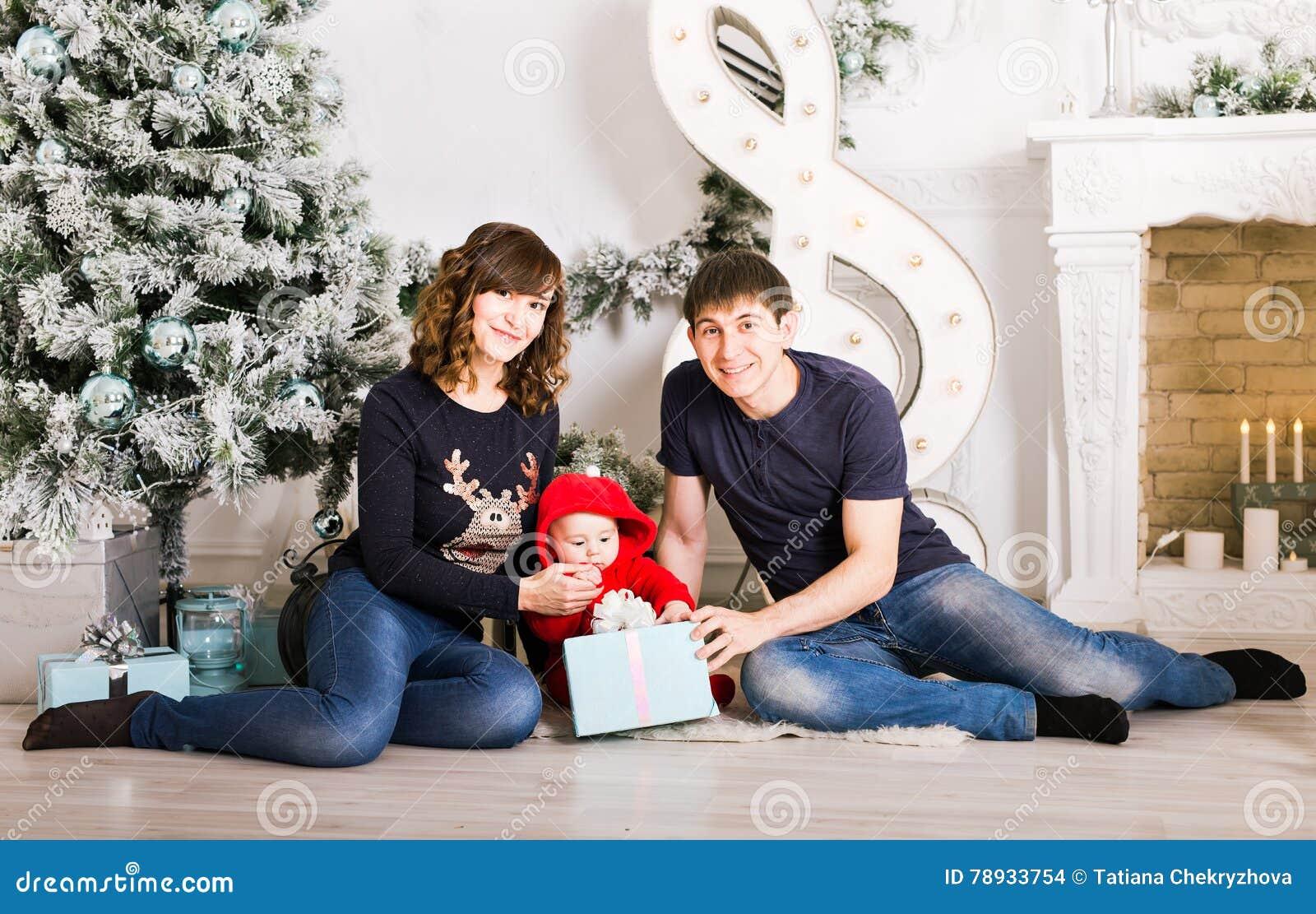 Happy Family Holding Christmas Gifts Near Xmas Tree. Baby, Mother ...