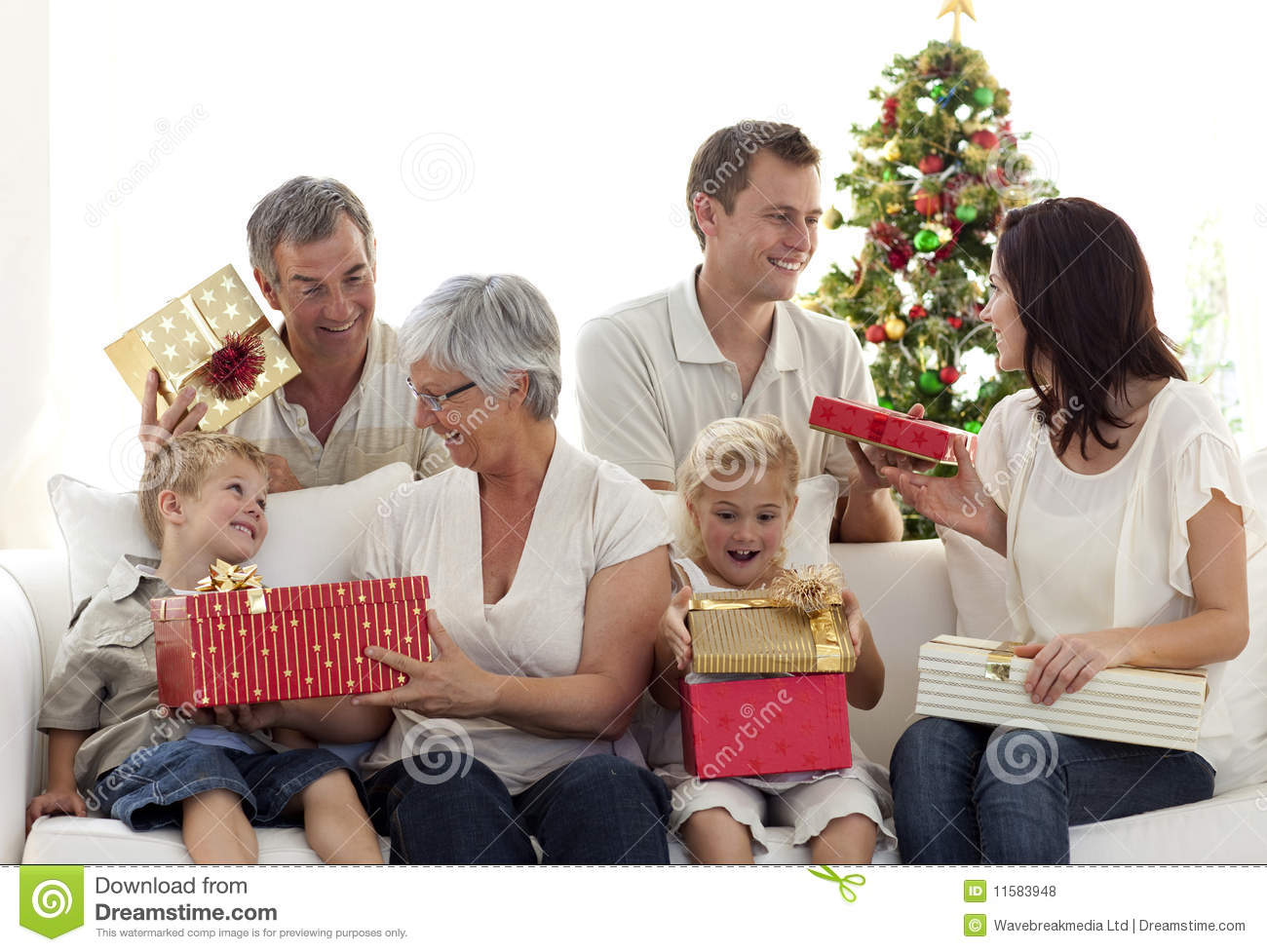 Happy family at home opening christmas presents stock