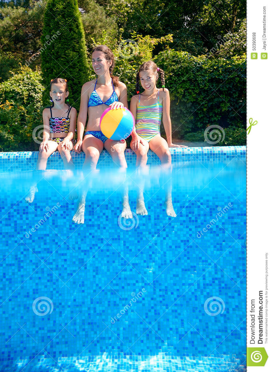 Happy Family With Kids Having Fun In Swimming Pool On