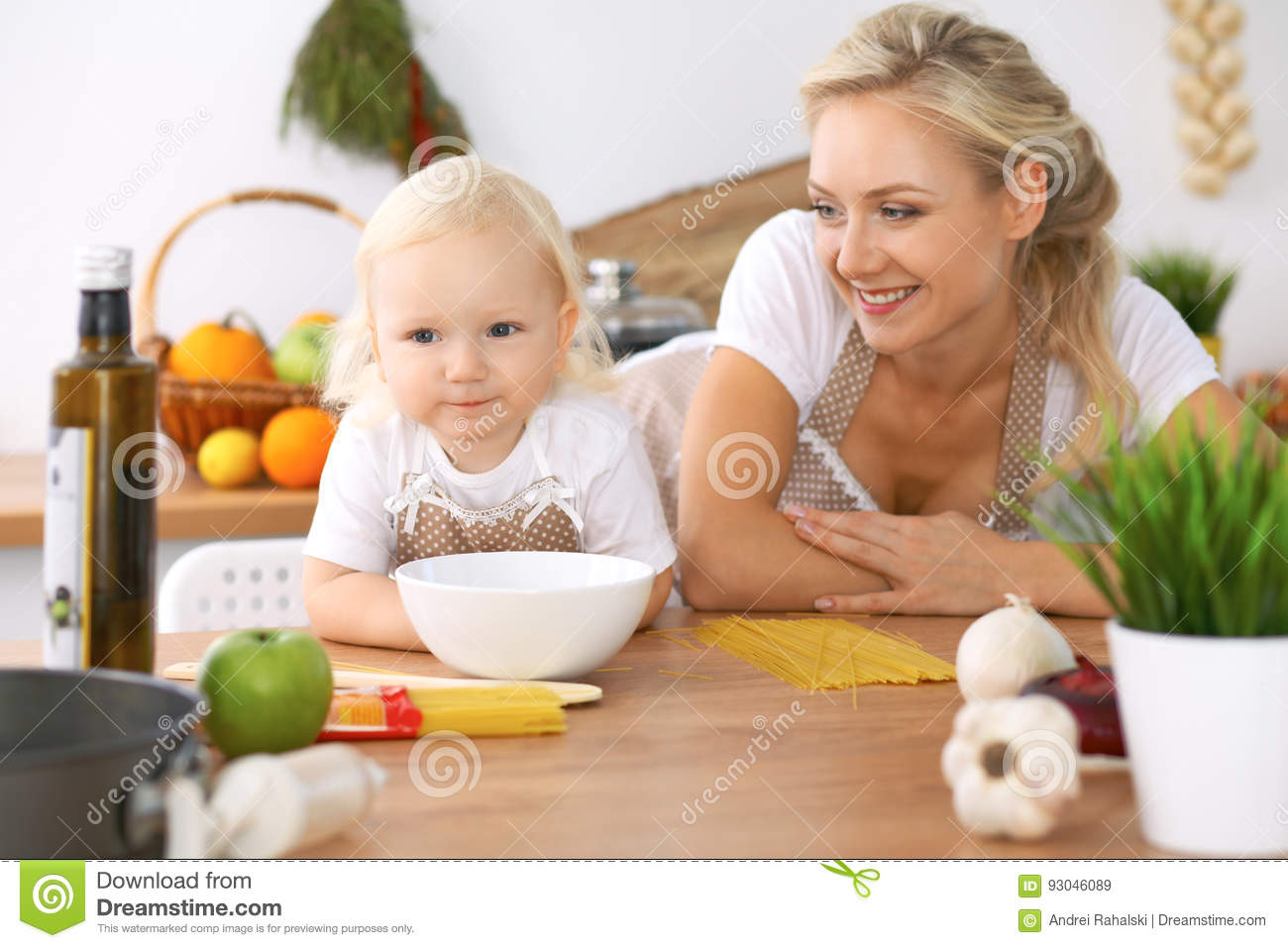 Happy family in kitchen - Happy Family In The Kitchen Mother And Child Daughter Cooking Tasty Breakfest Stock Photo
