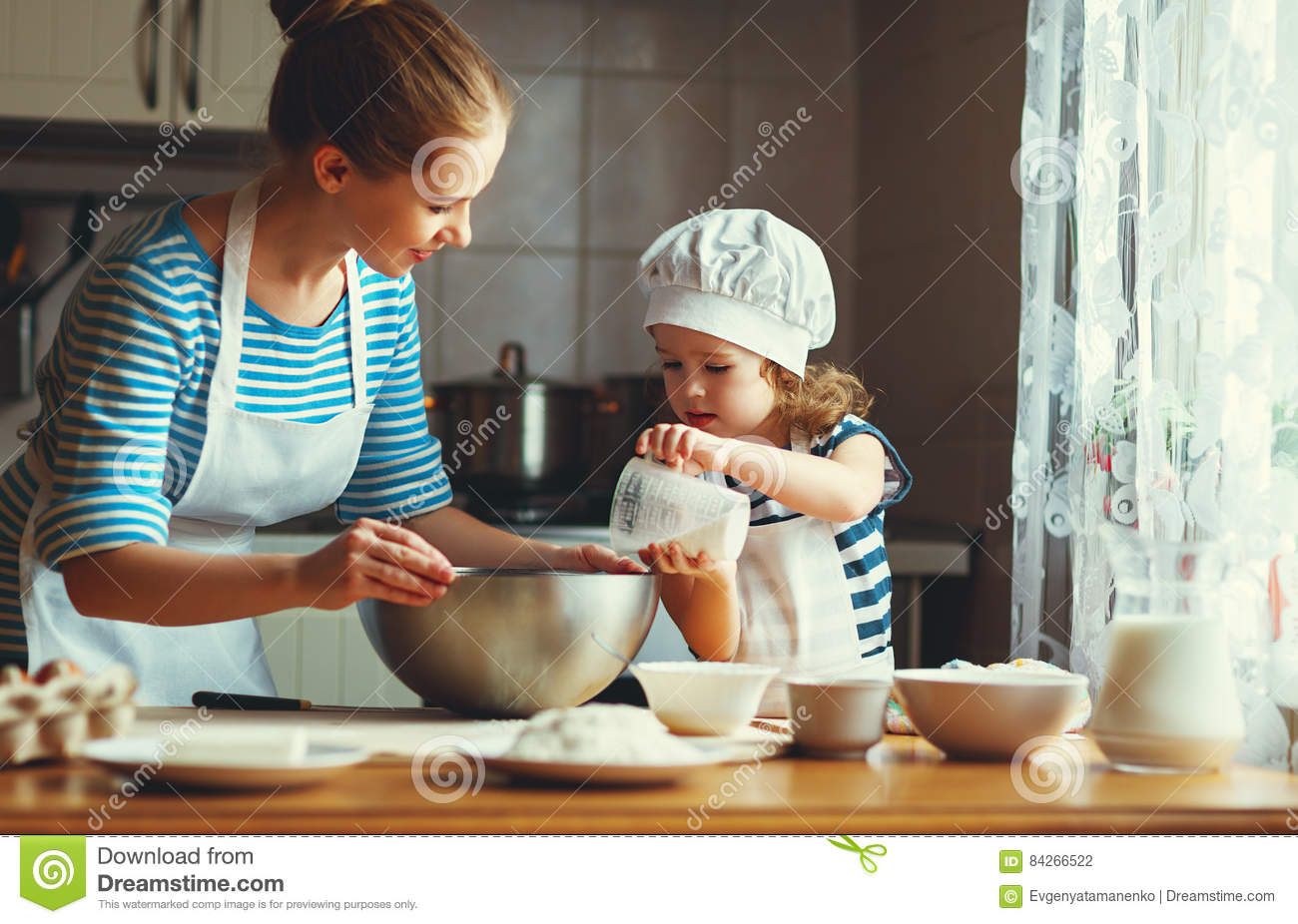 Happy family in kitchen - Happy Family In Kitchen Mother And Child Preparing Dough Bake