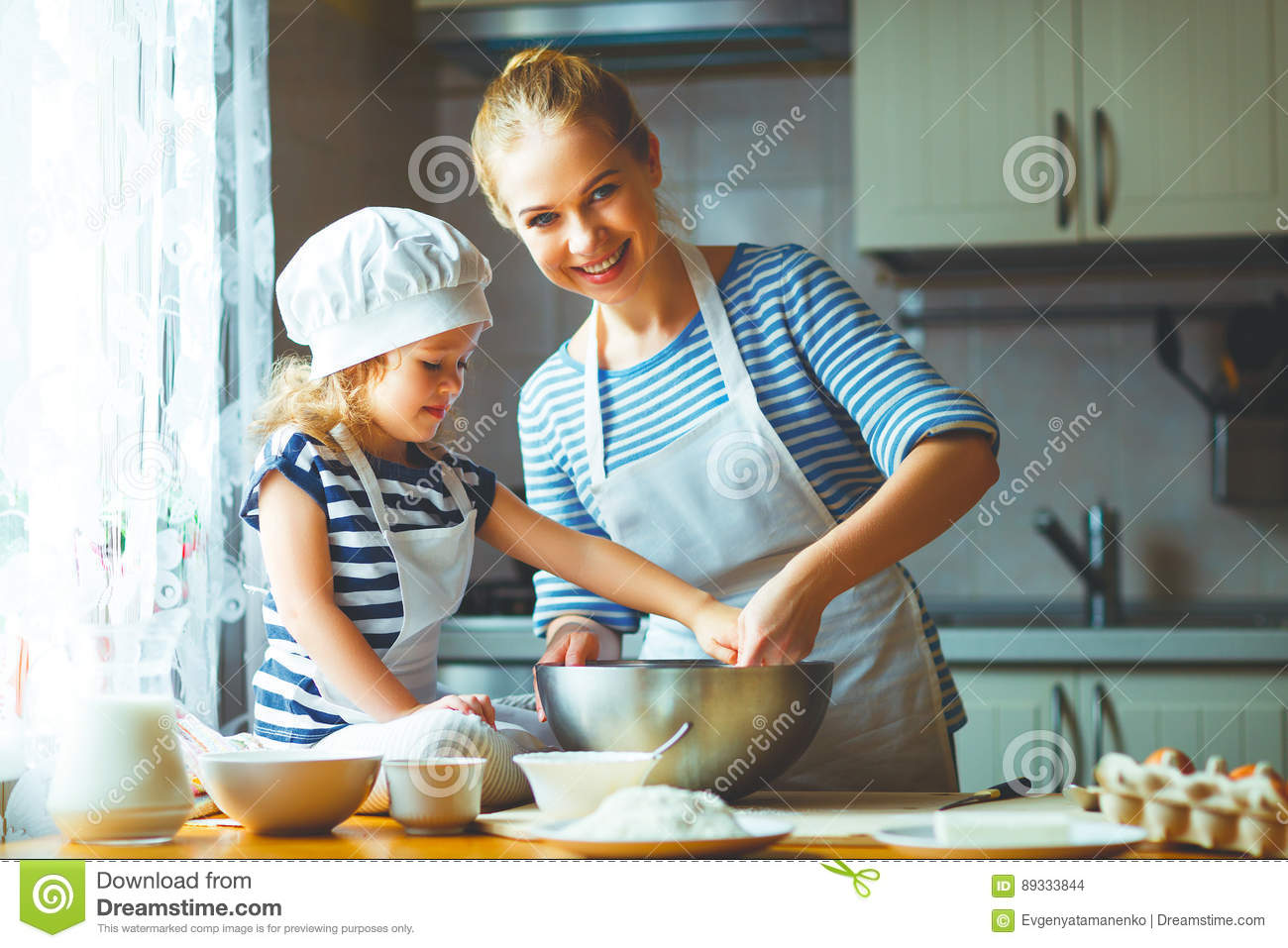 Happy family in kitchen - Happy Family In Kitchen Mother And Child Preparing Dough Bake Stock Photo