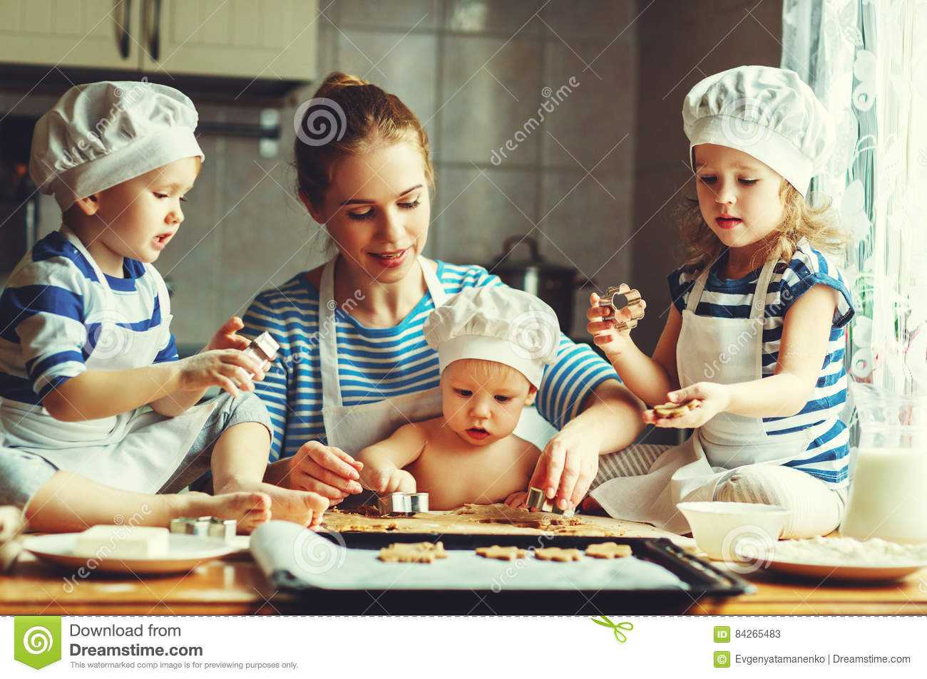 Happy family in kitchen - Happy Family In Kitchen Mother And Children Preparing Dough Ba