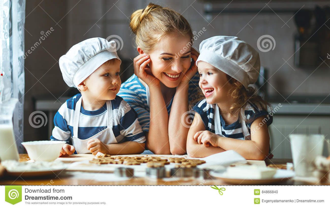 Happy family in kitchen - Happy Family In Kitchen Mother And Children Preparing Dough Ba Stock Photo