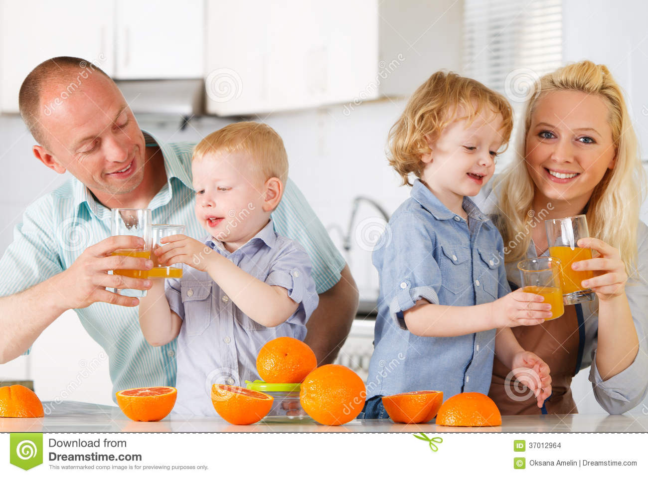 Happy family in kitchen - Family Juice Kitchen