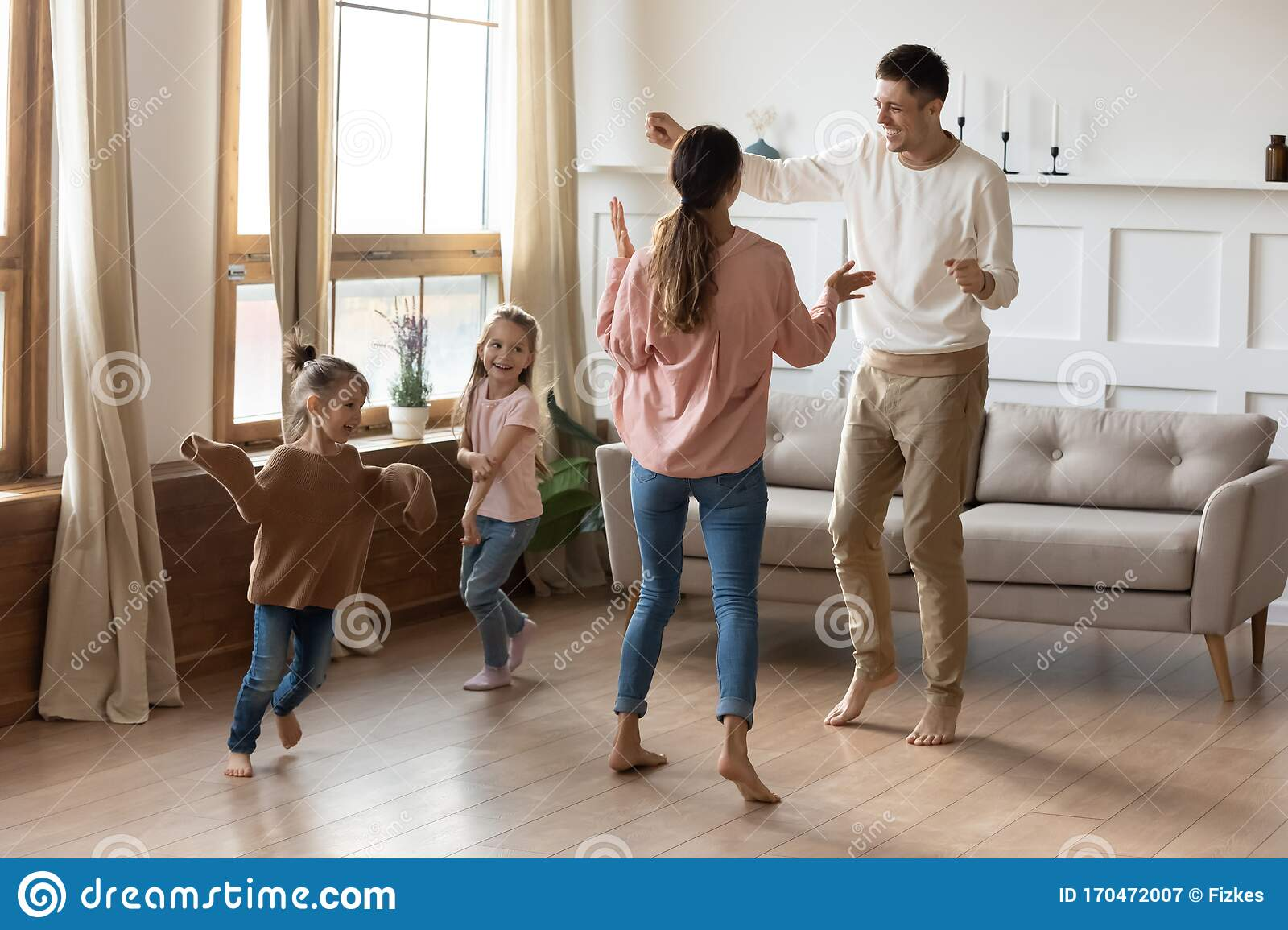 Happy Family With Little Kids Dancing In Living Room Stock ...