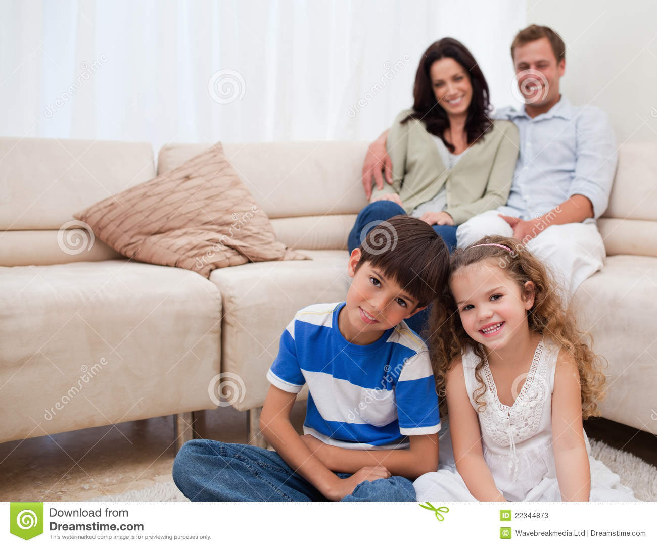 Happy family in the living room stock photos image 22344873 for Family in the living room