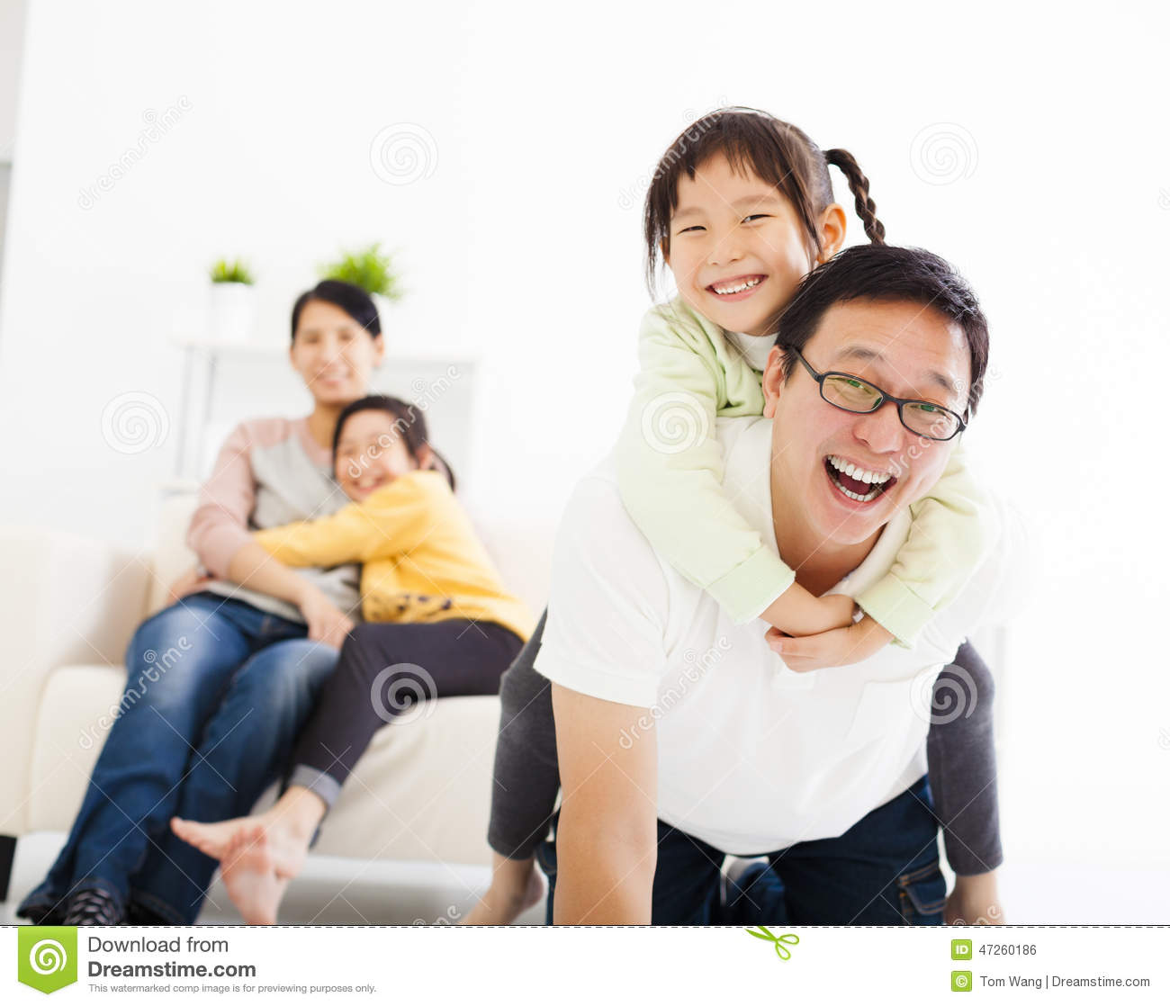 Family In Living Room: Happy Family In The Living Room Stock Photo
