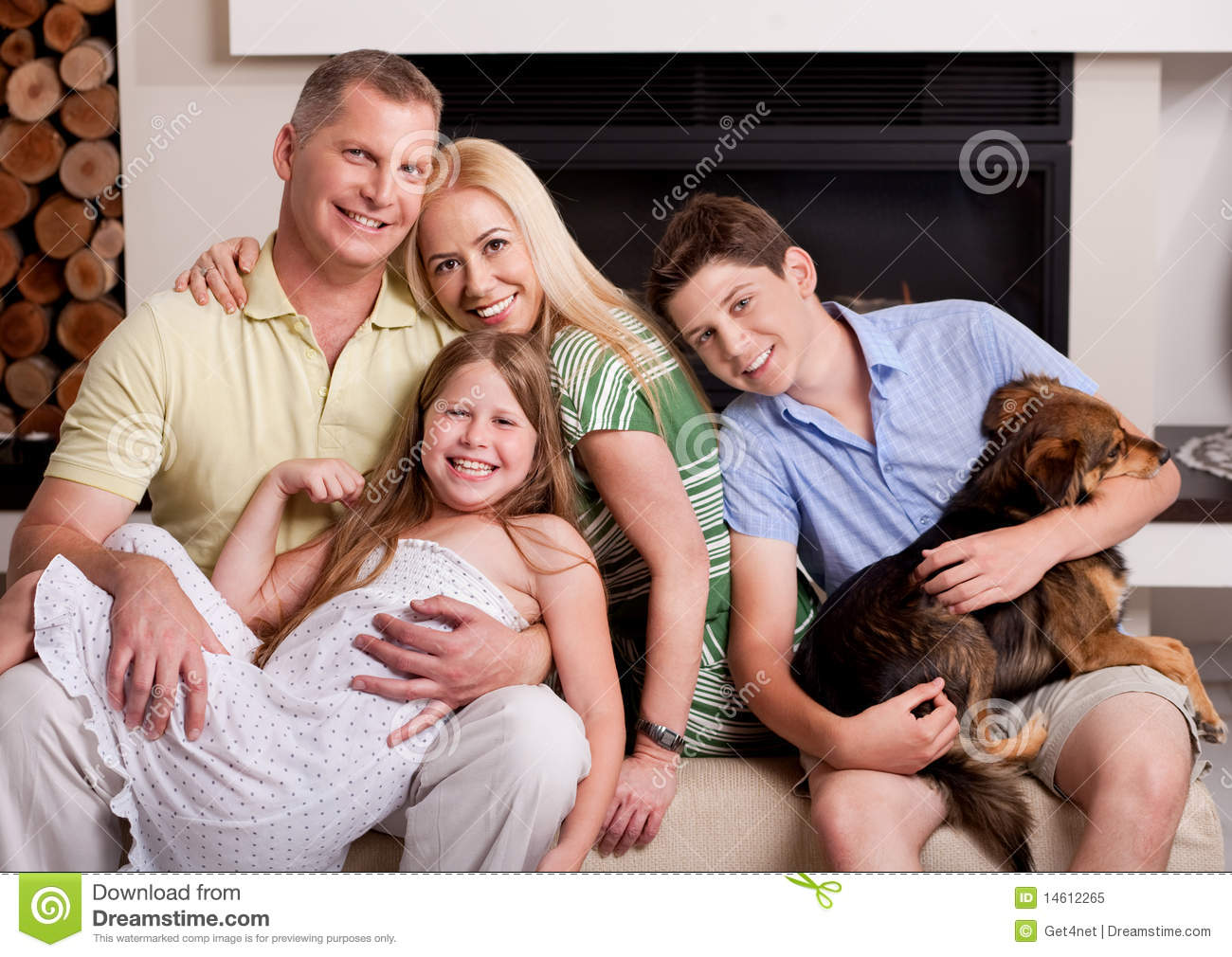 Happy family in living room with dog stock image image for Family in a living room