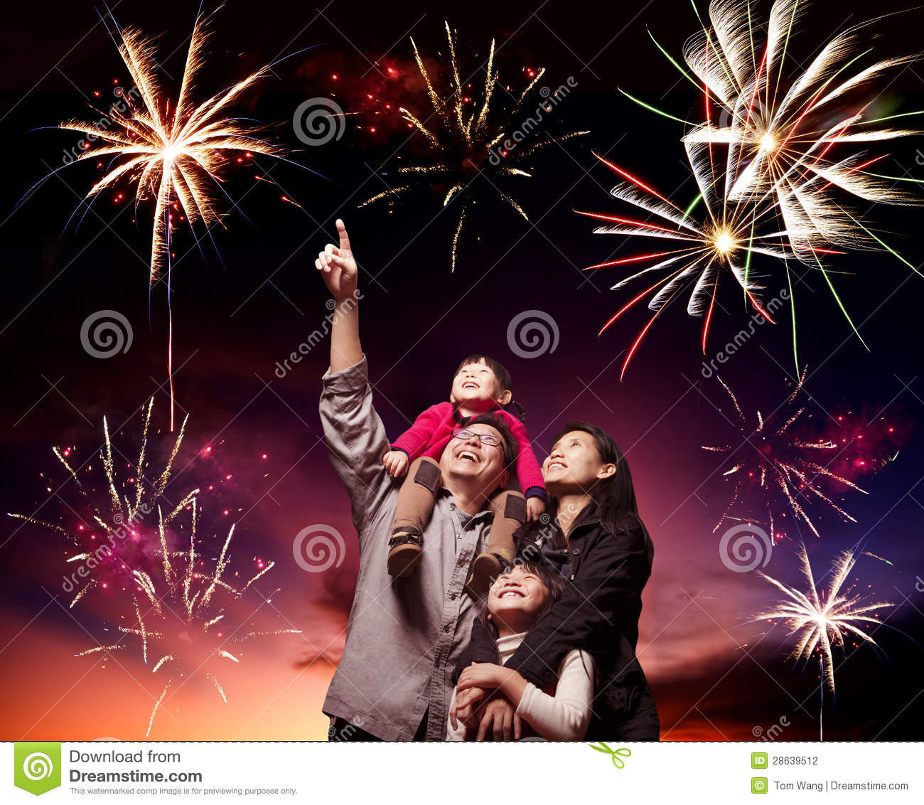 happy family looking fireworks stock photography