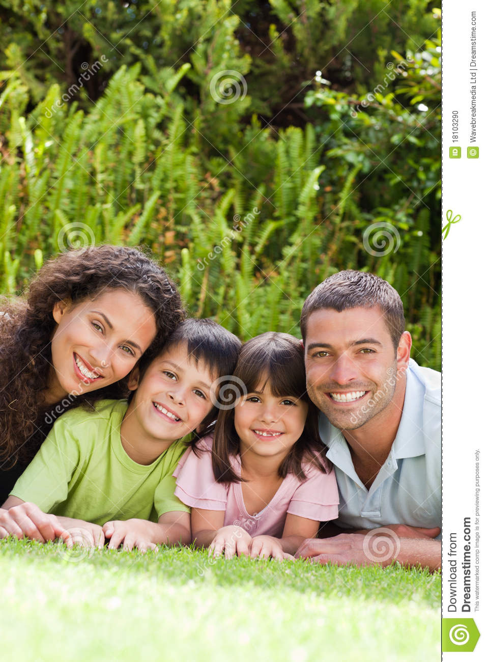 Happy Family Lying Down In The Garden Stock Photo Image