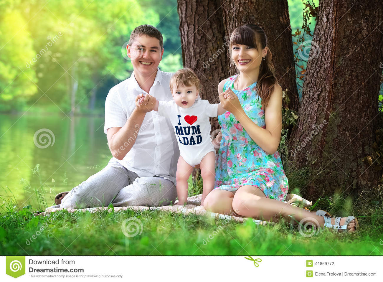 happy family mom dad and little son having fun in the park on stock photo image 41869772. Black Bedroom Furniture Sets. Home Design Ideas