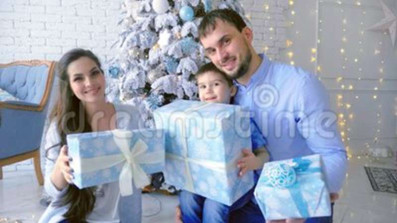 Happy family, mom dad son, pile up boxes with gifts up  Christmas  background  Decoration, surprise