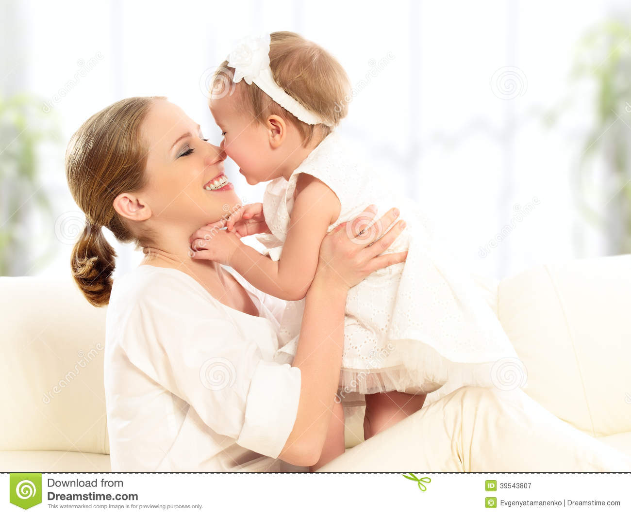Happy family. Mother and baby daughter plays, hugging, kissing