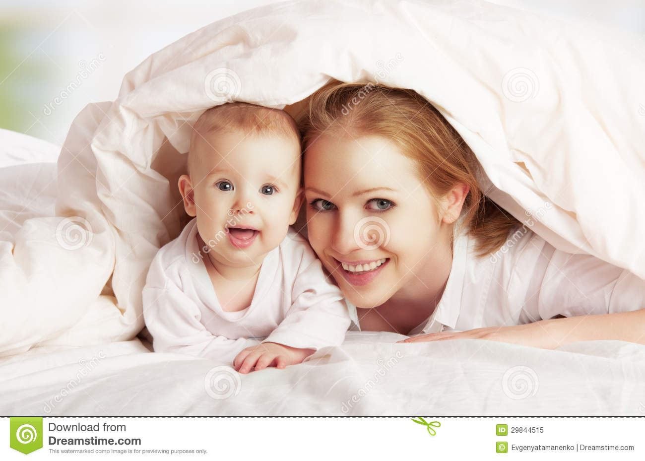 Happy Family. Mother And Baby Playing Under Blanket Stock