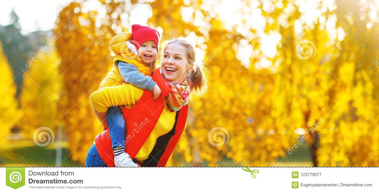 Happy family mother and baby son on autumn walk