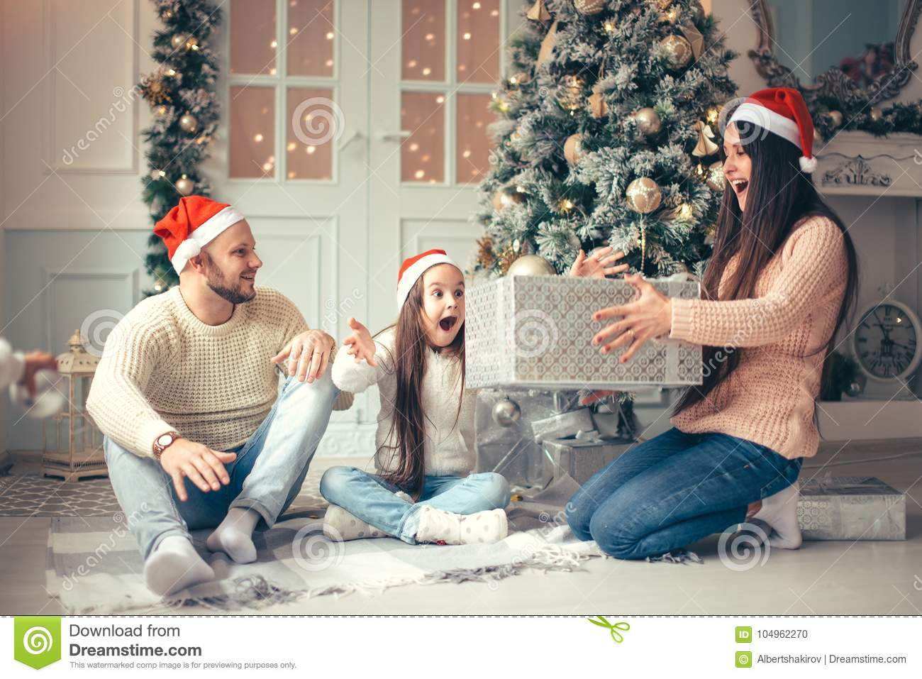 Happy Family Mother And Child Daughter On Christmas Morning With ...