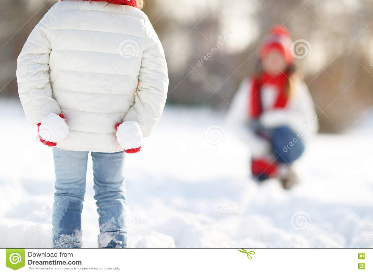 Happy Family Mother And Child Daughter Having Fun, Playing Snowb Stock Photo