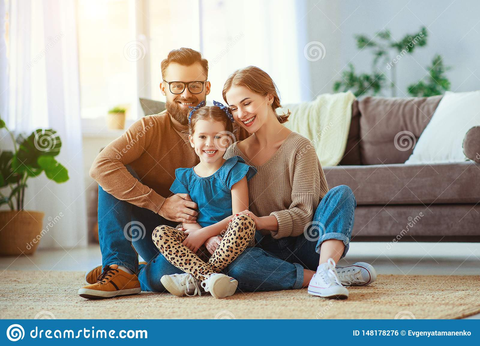 Happy family mother father and child daughter laughing   at home