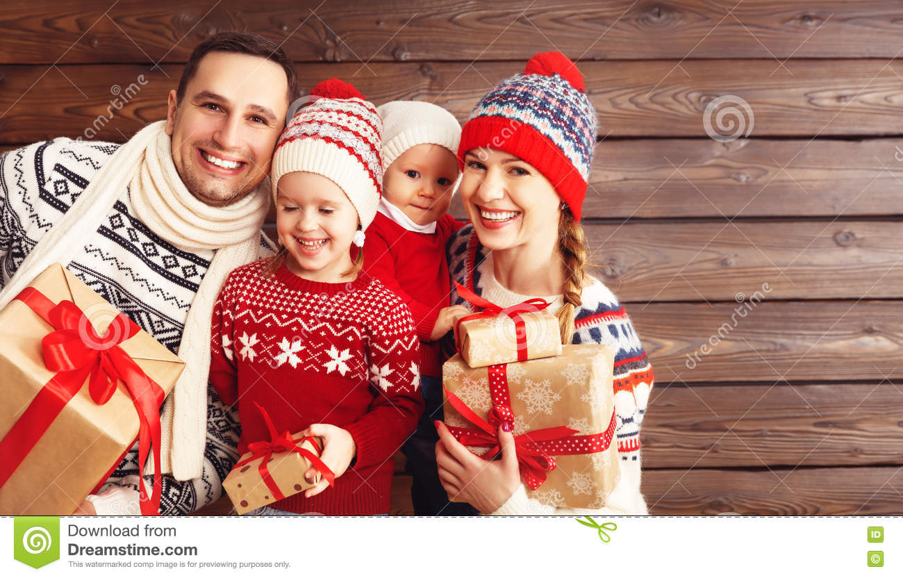 Happy Family Mother, Father And Children With Christmas Gifts On ...