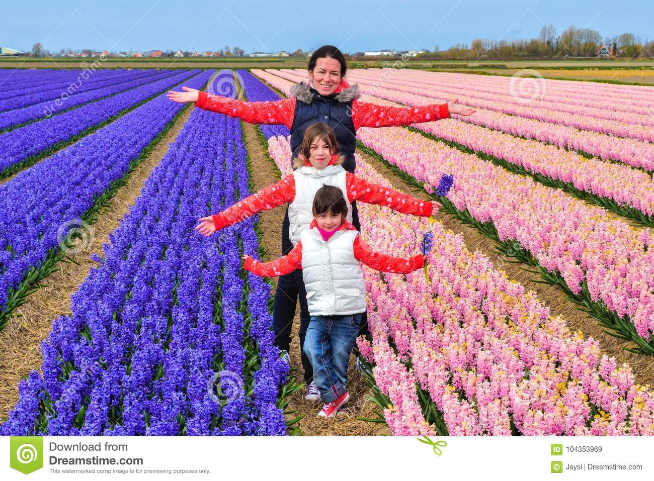 Happy Family Of Mother And Kids On Spring Flowers Field Vacation