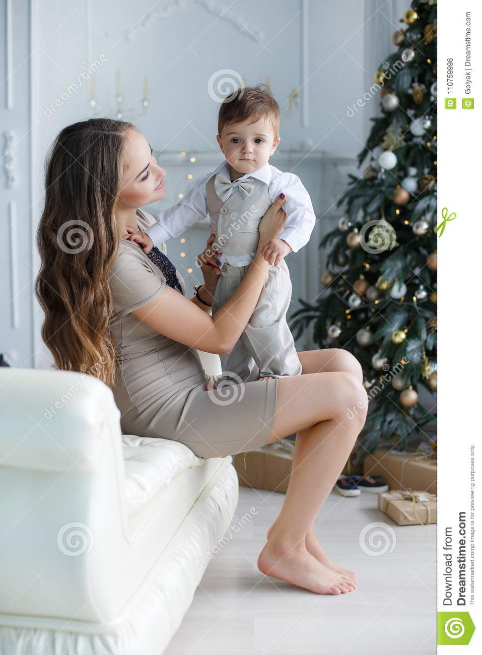 Mom With A Small Son Near A Beautiful Christmas Tree In His House Stock Photo Image Of Domestic Decorating 110759996