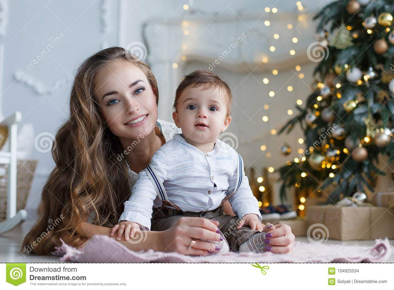 Mom With A Small Son Near A Beautiful Christmas Tree In His House Stock Photo Image Of Garland Joyful 104925534