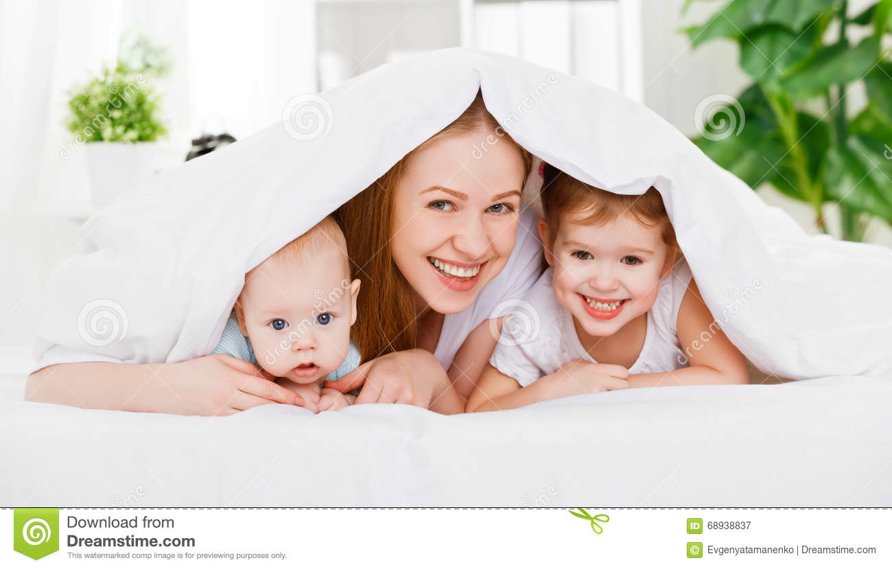 happy family mother and two children son and daughter in bed un stock image image 68938837. Black Bedroom Furniture Sets. Home Design Ideas