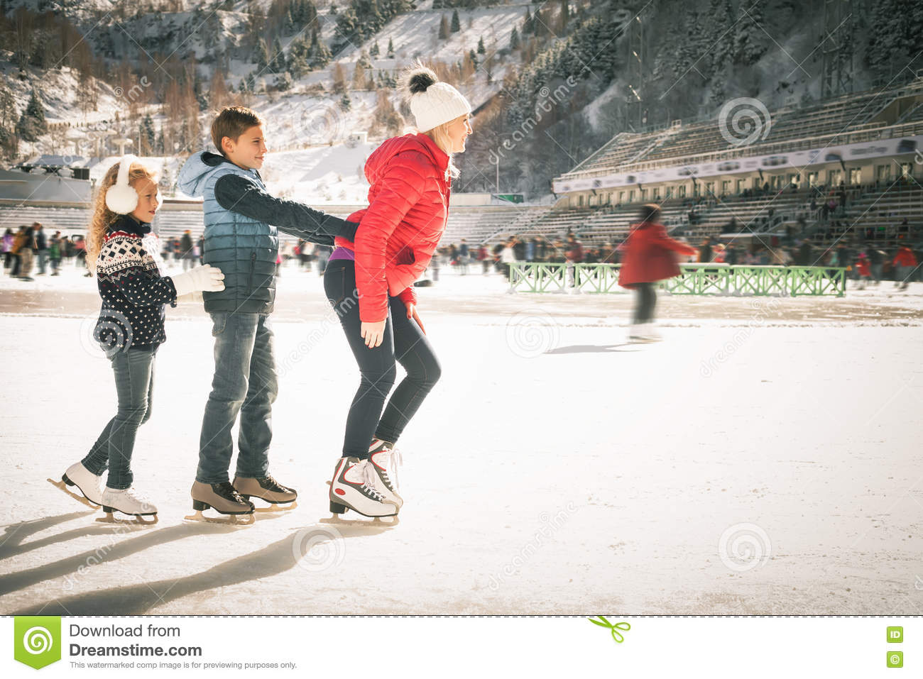 happy family outdoor ice skating at rink winter activities stock