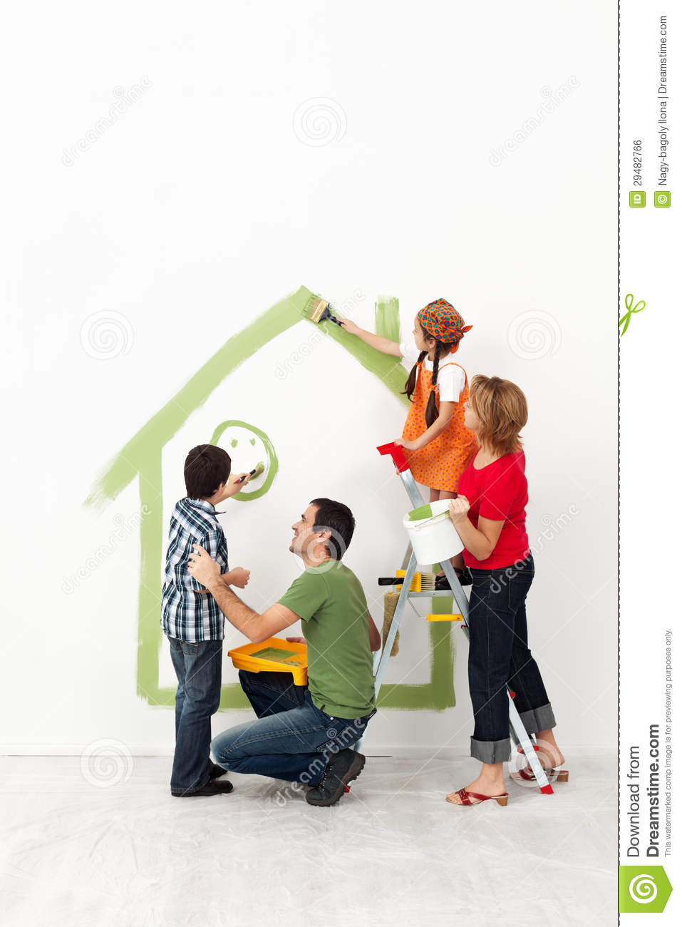 2012 Family Home Decorating Ideas: Happy Family Painting Their Home Together Stock Photo
