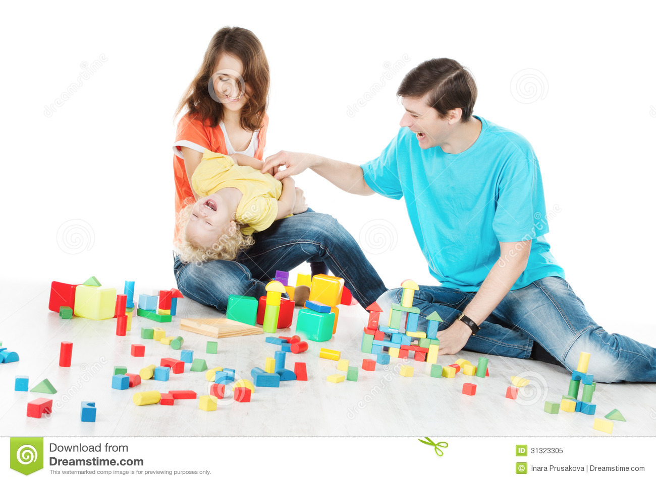 Toys For Family : Happy family parents playing toys blocks with child stock
