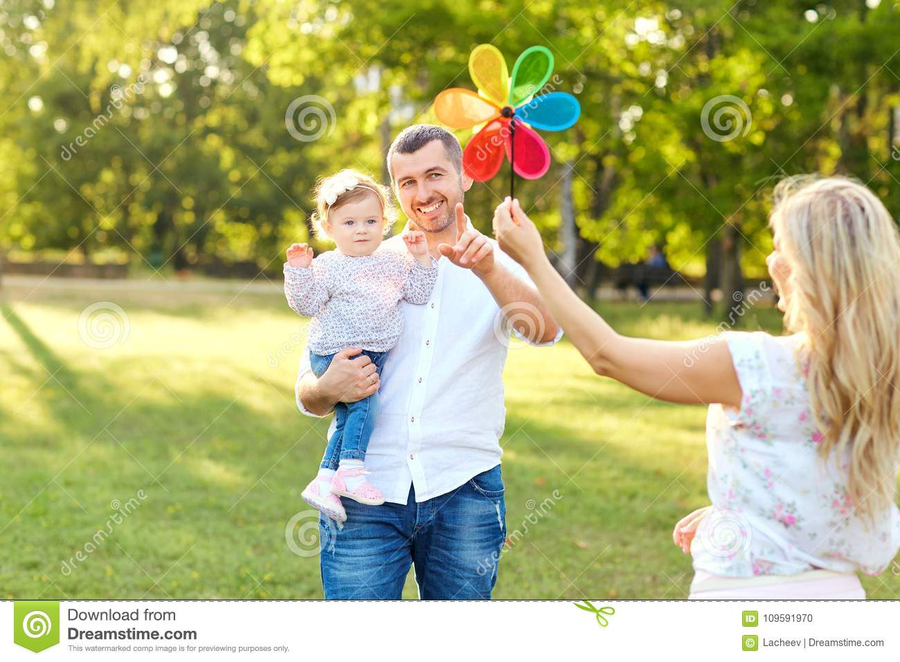 Happy family in a park in summer autumn.