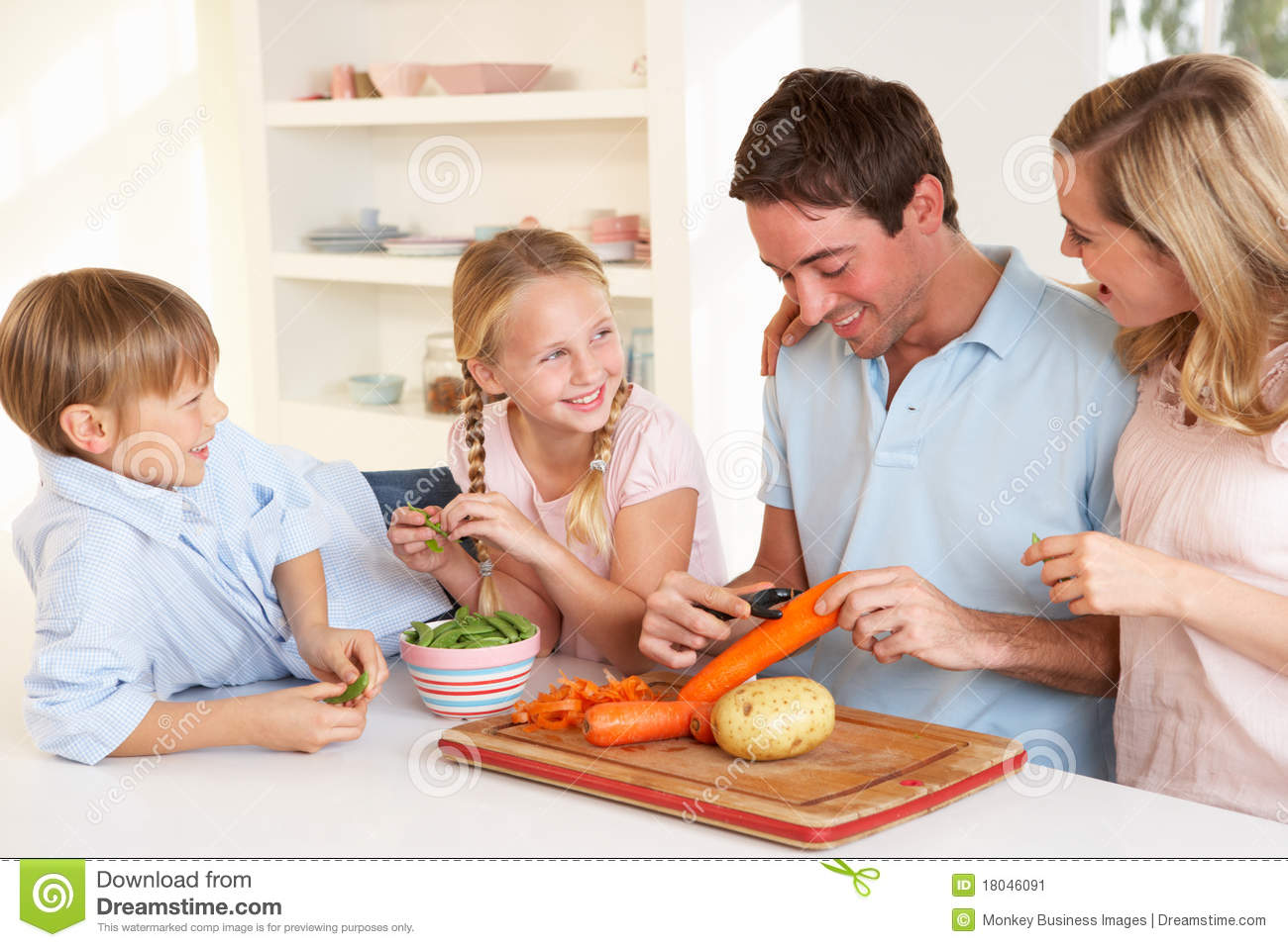 Family Kitchen Happy Family Peeling Vegetables In Kitchen Royalty Free Stock