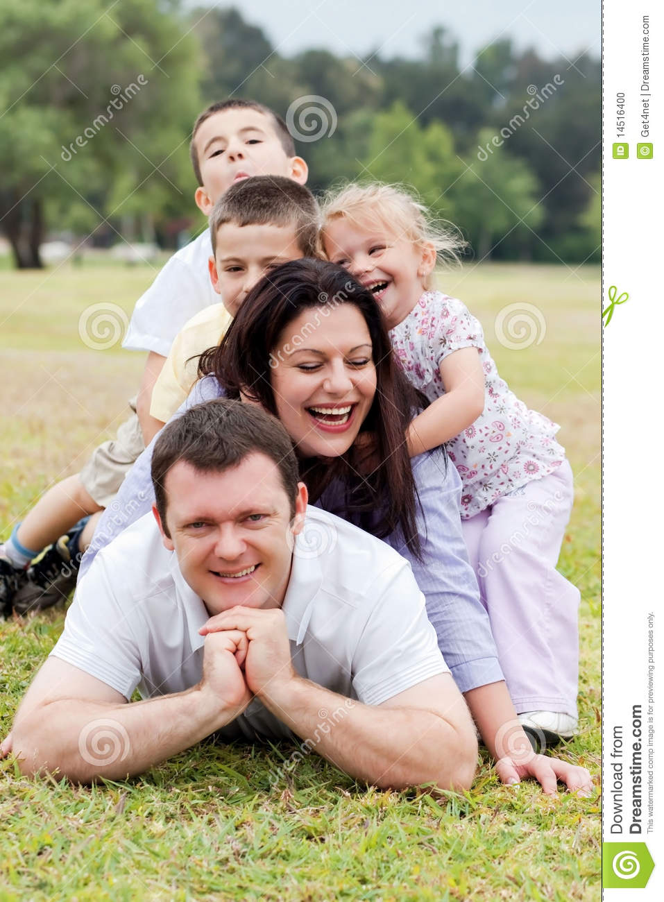 Happy family piled up on the park