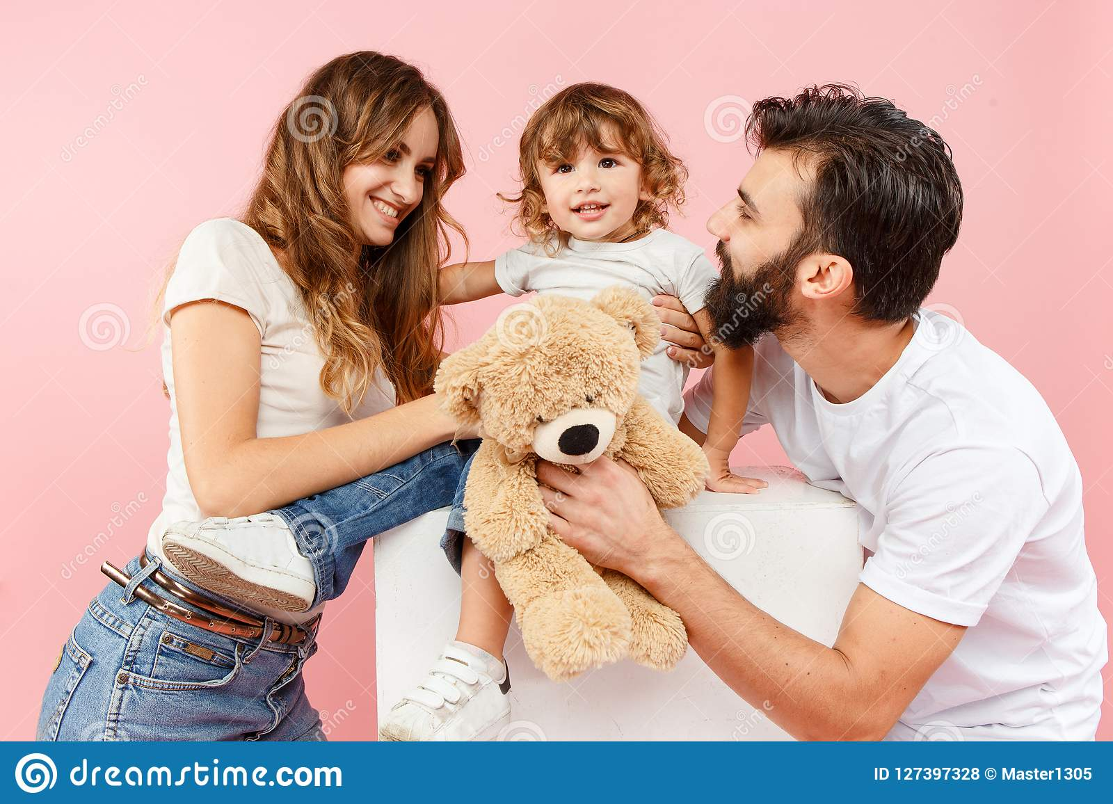 A Happy Family On Pink Background Stock Photo Image Of Childhood