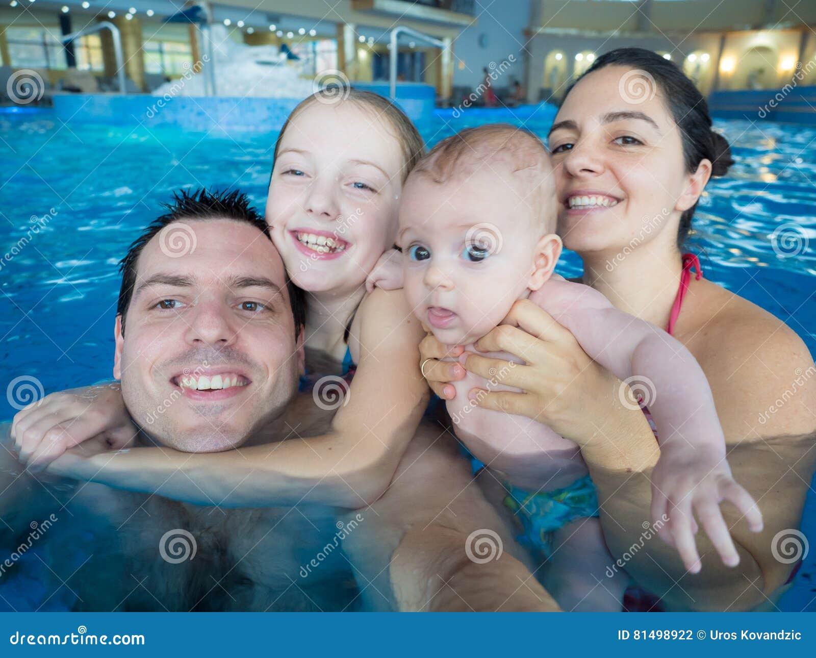 Happy family in pool