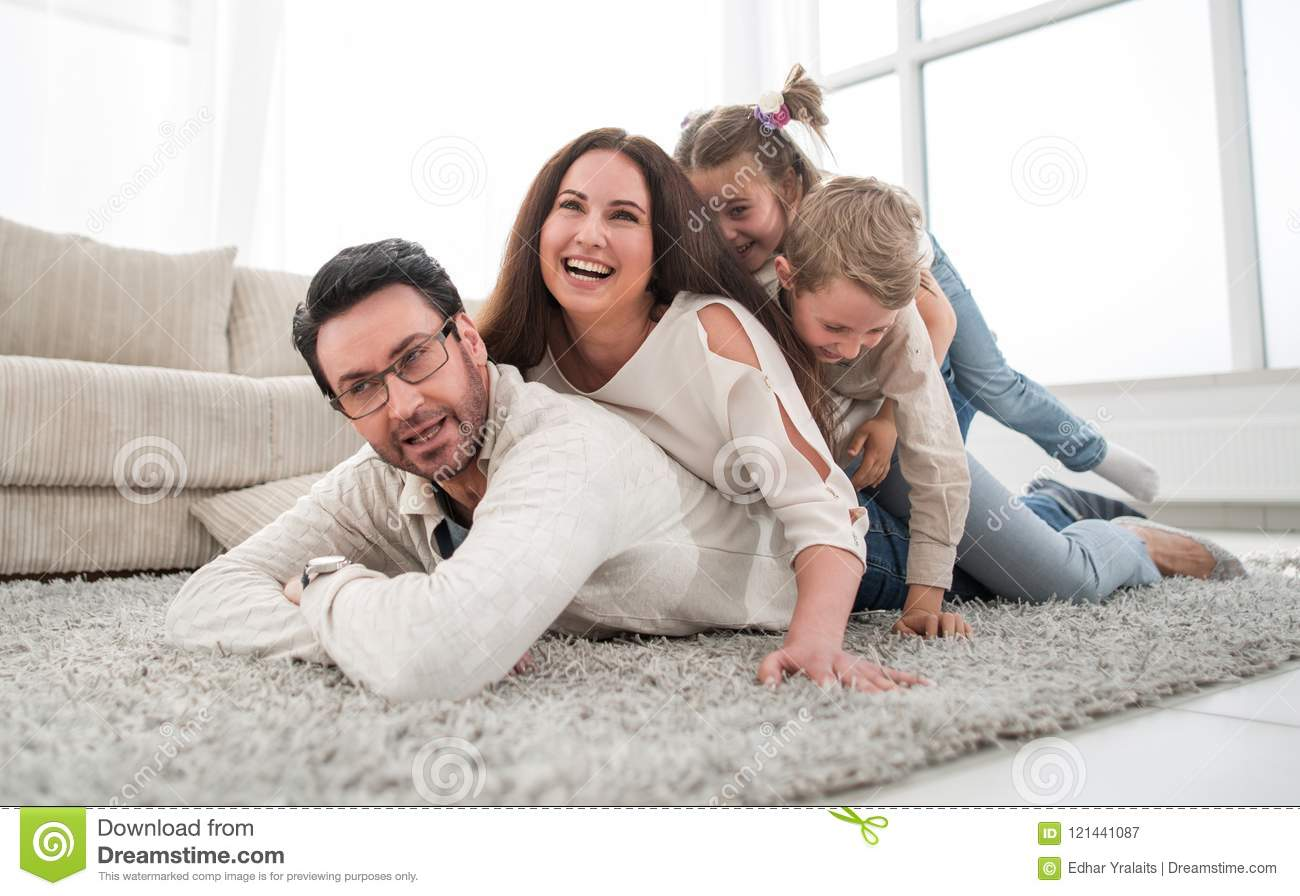 Happy Family Relaxing In Comfortable Living Room Stock Image ...