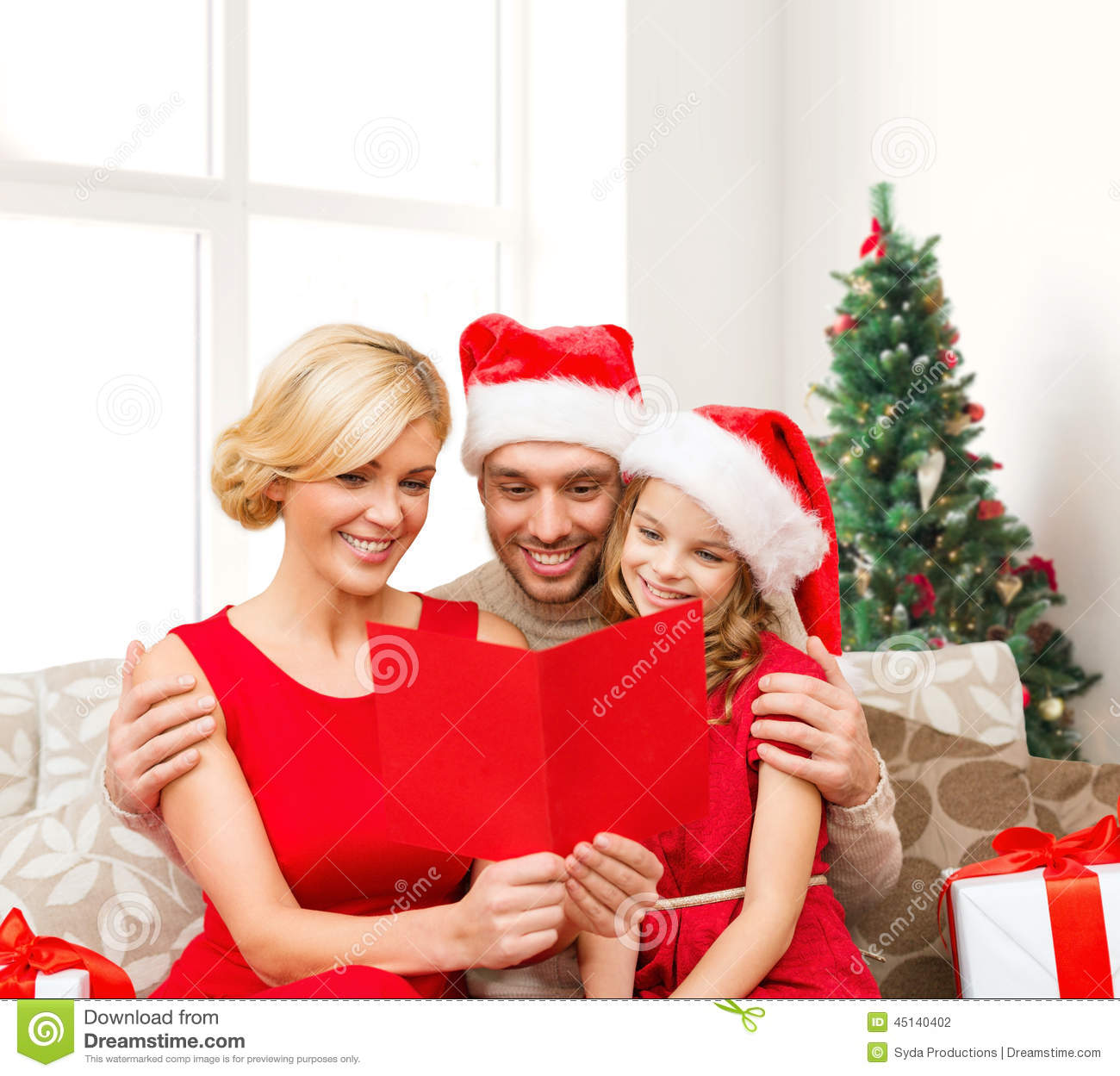 Happy Family In Santa Hats With Greeting Card Stock Photo Image Of