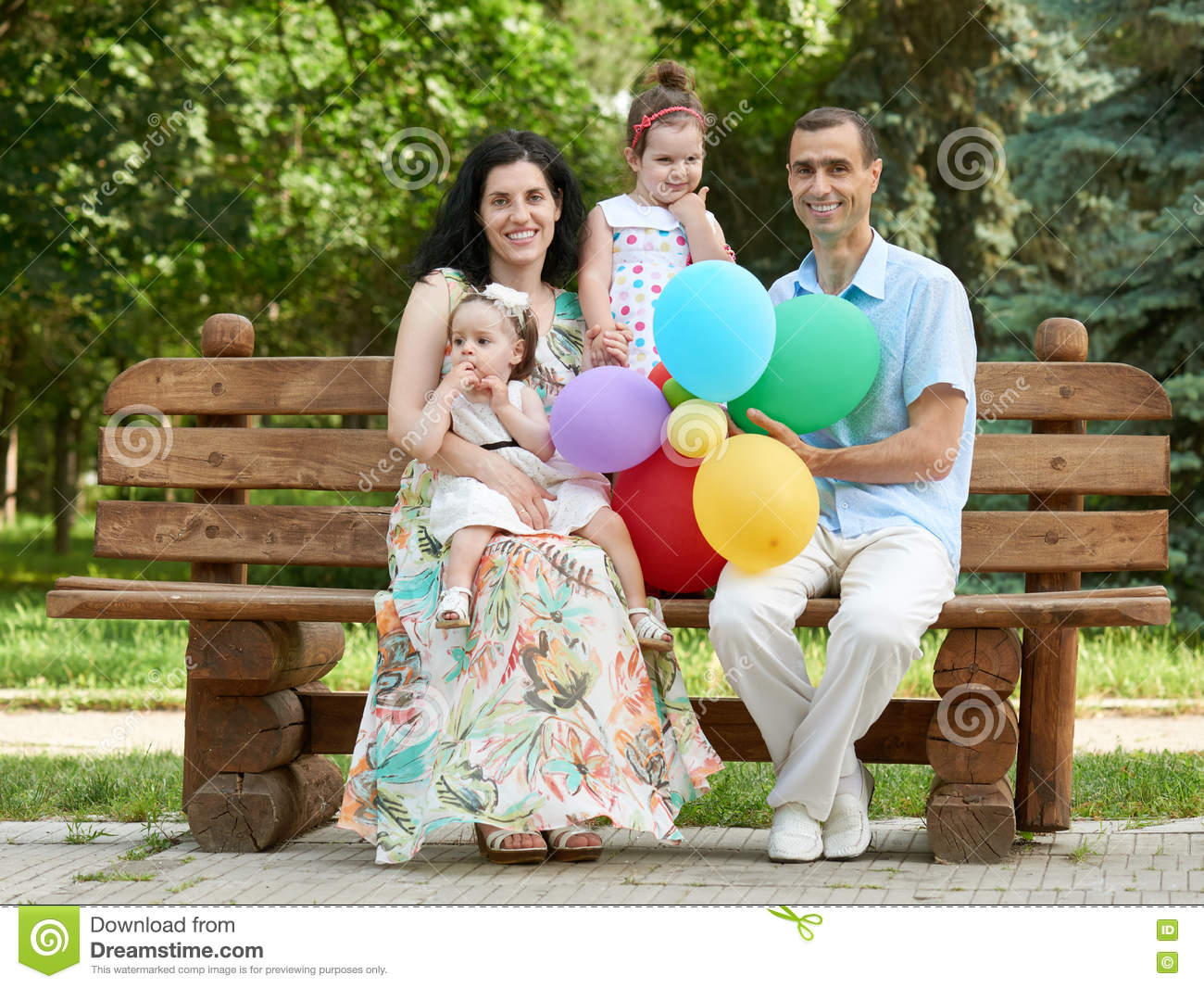 Marvelous Happy Family Sit On Wooden Bench In City Park Summer Season Bralicious Painted Fabric Chair Ideas Braliciousco