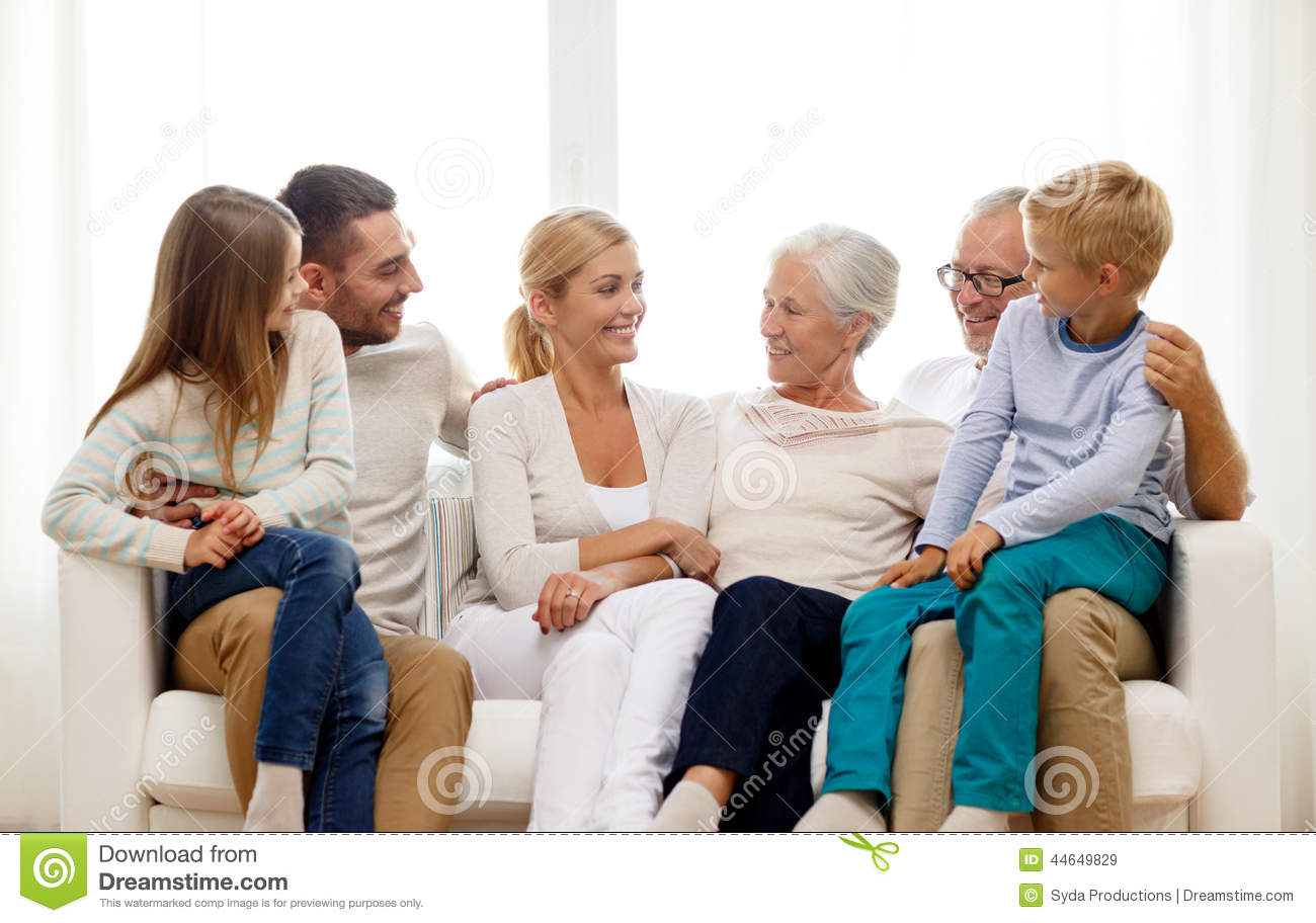 Happy family sitting on couch at home stock image image for What is family home