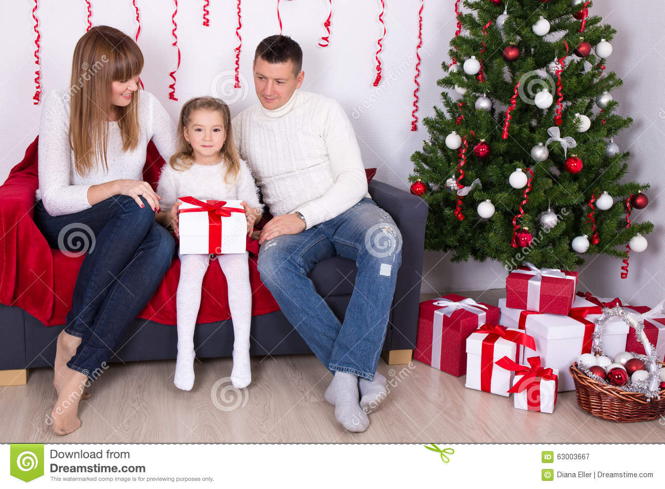 Happy family sitting in decorated living room with for Living room ideas young family