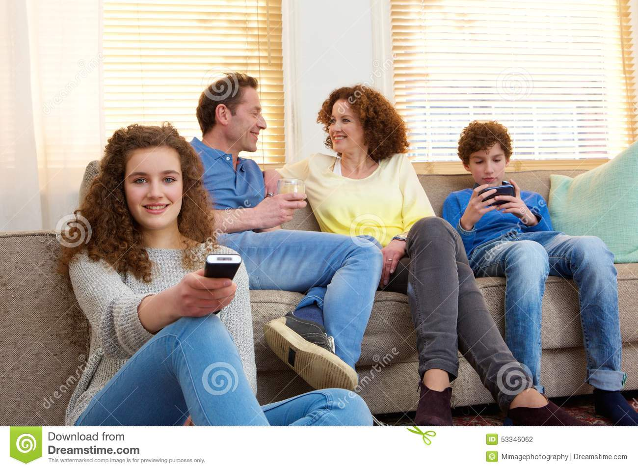 Happy Family Sitting At Home Relaxing In Living Room Stock