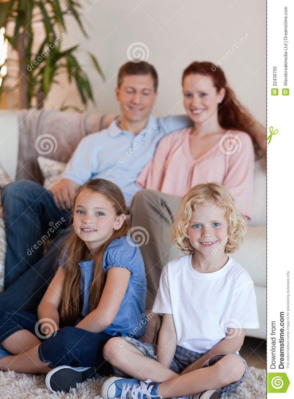Happy Family Sitting In The Living Room Stock Photo