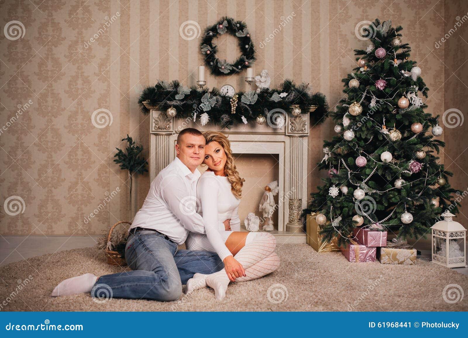 Happy Family Sitting Near Christmas Tree Stock Photo