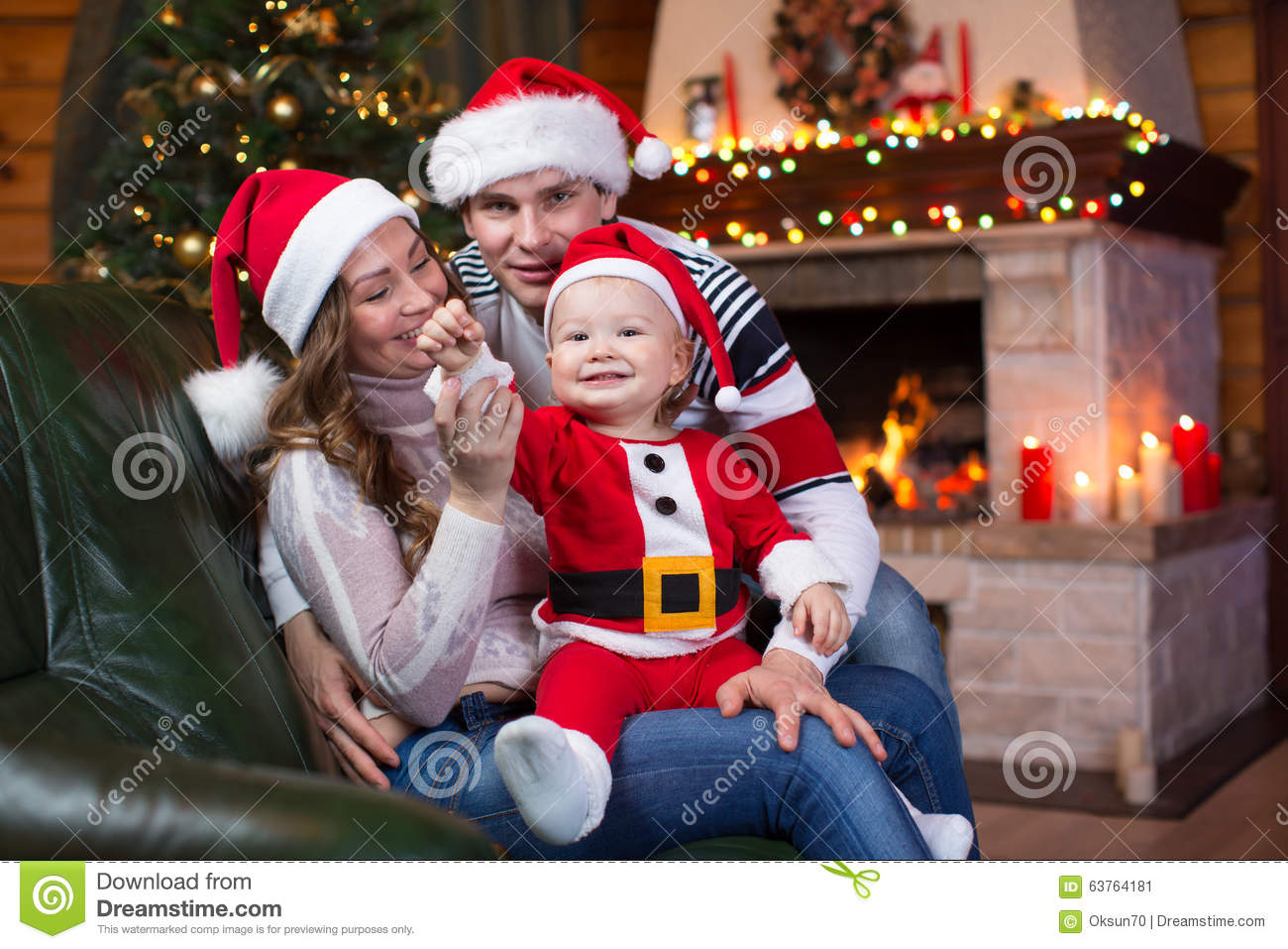 Father weared santa claus and kid boy open gift sitting Photoshop santa in your living room free