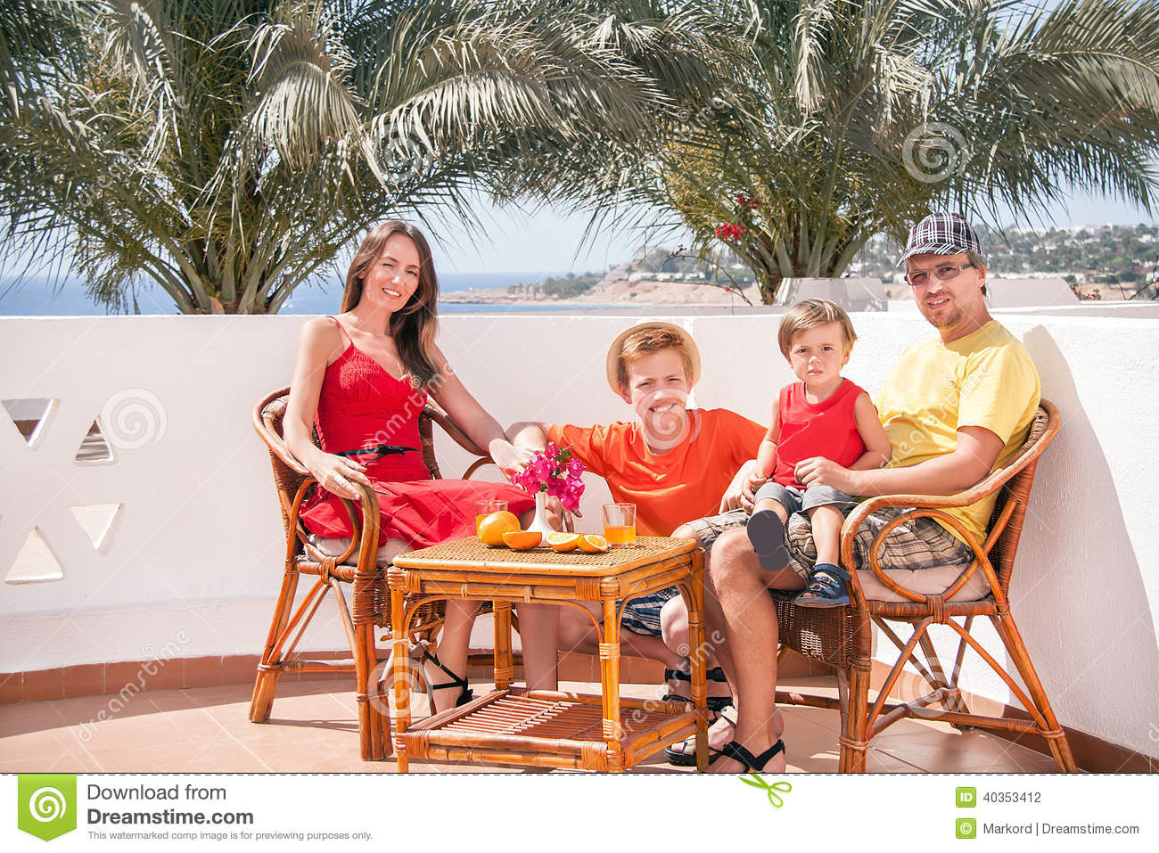 Happy family is sitting at the terrace stock photo for Kids on the terrace