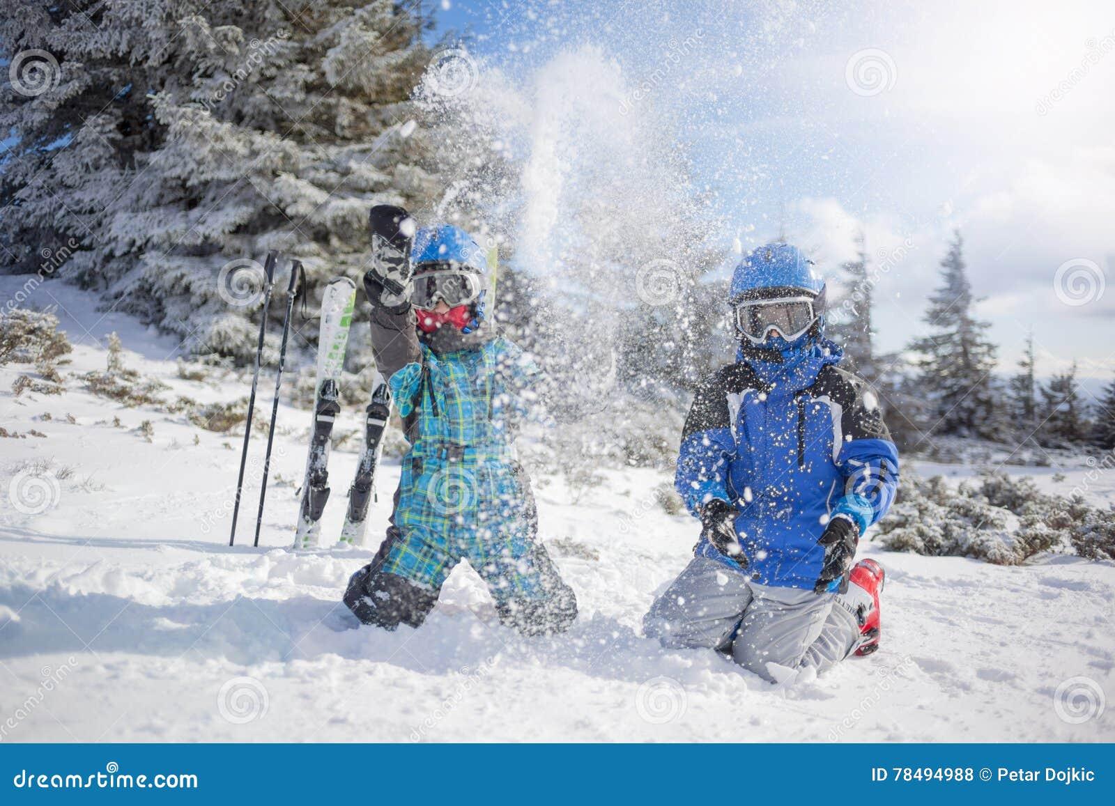 Happy family ski team fun on beautiful mountain
